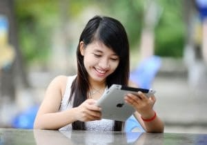 underage girl using ipad tablet to gamble online
