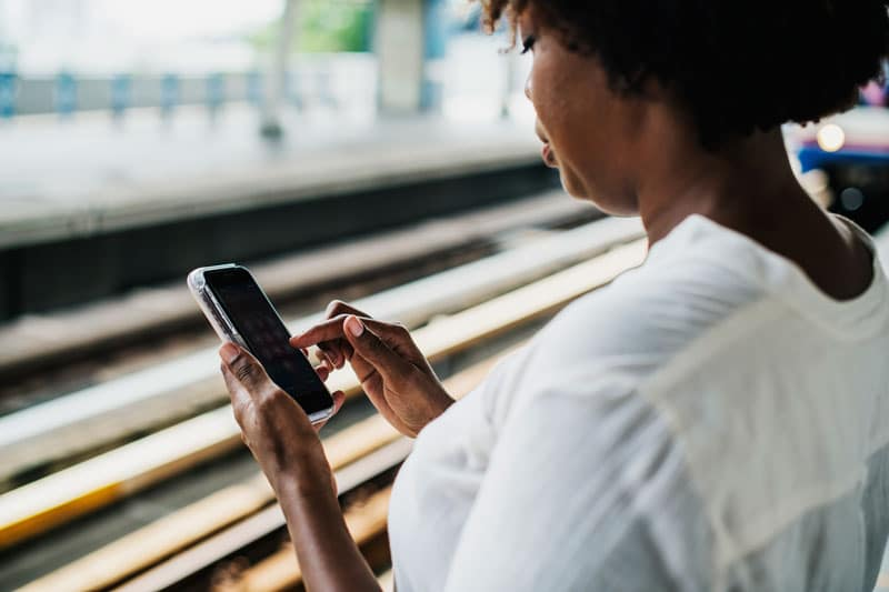 woman using a mobile phone in public