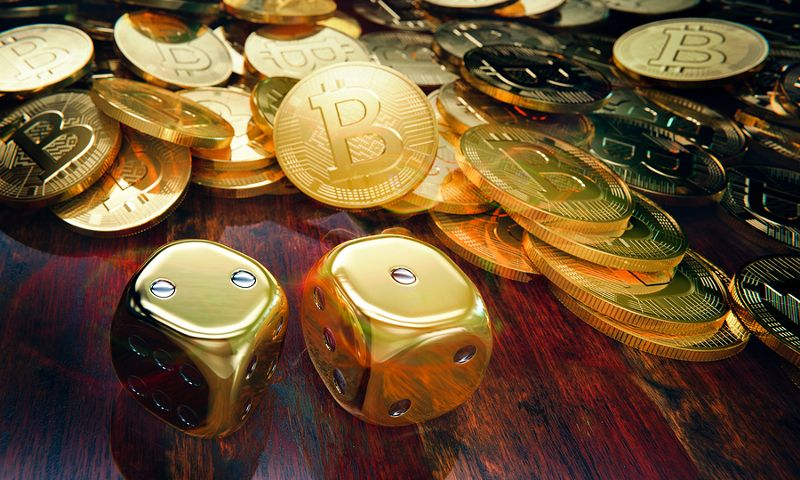 image of bitcoins and game dice